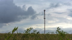 Tower communications on a background of storm clouds storm Stock Footage