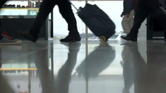 People With Luggage Passing By The Window In Airport Stock Footage