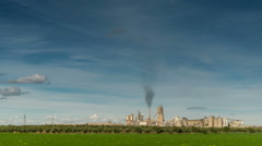 Green Field And Factory With Dark Smoke Coming Out Of Chimney Stock Footage