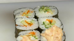 Cook gets sauce on sushi and finalizing. Close up Stock Footage