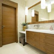 Modern toilet interior with wooden door and furniture - stock photo