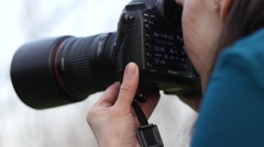 Photo shooting process female photographer at work take pictures by big camera Stock Footage