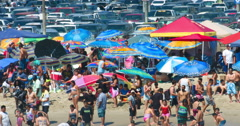 Crowd of people swim in Santa Monica Beach, Los Angeles, California 4K RAW Stock Footage