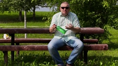 Angry man with bottle of alcohol sitting and talking - stock footage