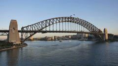 Australia Sydney Harbour Bridge from ship with small boat in distance Stock Footage