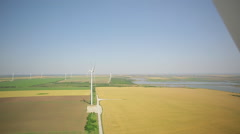 Wing HB wind turbine against the blue sky and wheat field Stock Footage