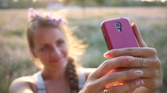 Make photo - young lady taking selfie picture via smart phone on nature sunset Stock Footage