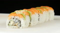 Sushi chef sprinkles rolls by sesame. Close up Stock Footage