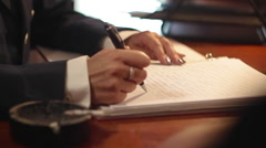 The woman officer write a letter on the desk Stock Footage
