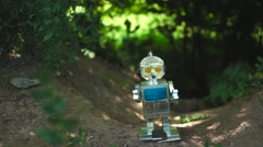 Robot Toy standing in the park Stock Footage
