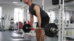 Bodybuilding - young man hard training in gym Stock Footage