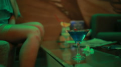 Beautiful classic pinup girl in club drinking a cocktail Stock Footage