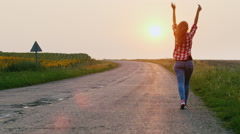 Freedom and the path to the dream - the woman goes into the sunset on a country Stock Footage