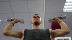 Bodybuilding guy training in gym - the load on the shoulder muscles Stock Footage