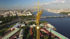 Close approach to angel on spire. Flight over Peter and Paul fortress. Unique Stock Footage