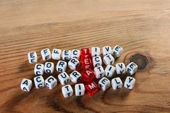 Team acronym on dices Stock Photos