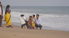 Indian Family making photo on beach,Puri,India Stock Footage