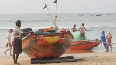 Boat is being pulled on beach with pulley,Puri,India Stock Footage