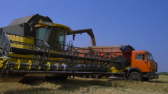Combine-harvester unload grain Stock Footage