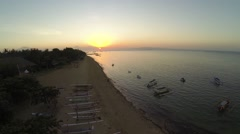 Sunrise in Sanur beach with view of Agung volcano, aerial shot Stock Footage