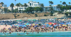 People swim in the Pacific Ocean in Santa Monica Beach in Los Angeles 4K RAW Stock Footage