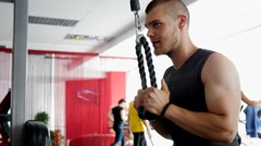 Sports bodybuilder young man hard training workout in gym Stock Footage