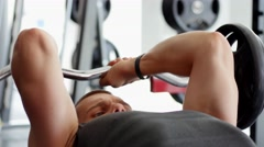 Sports bodybuilder young man hard training muscles workout in gym Stock Footage