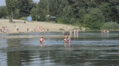 People are bathing in the river shallow. Stock Footage