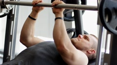 Sports bodybuilder young man hard training muscles in gym Stock Footage