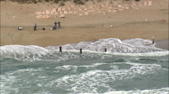 Fishermen On The Beach At Buxton Stock Footage