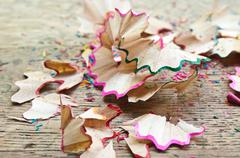 coloring pencil shavings on wooden desk - stock photo
