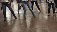 Western dancers dancing a choreography at a country festival Stock Footage