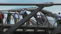 People walking along Millenium bridge London Stock Footage