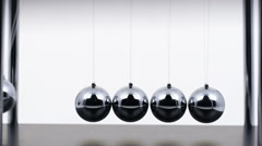 Slow Motion Newton's Cradle Stock Footage