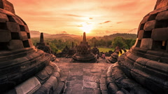 Buddist temple Borobudur at amazing sunset in Indonesia. 4K Timelapse - Java Stock Footage