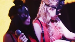 Mc girl and Dj girl in hare masks perform at turntable in nightclub. Dance Stock Footage