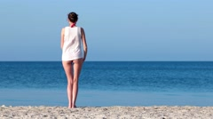 The seashore, the Spirit of freedom Beautiful girl raises her arms to the sky Stock Footage