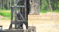 Pile driver in a construction site,A post which supports a beam-pile Stock Footage