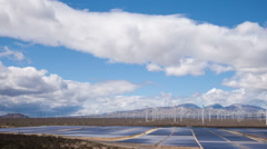 Solar And Wind Power Station In The Desert Stock Footage