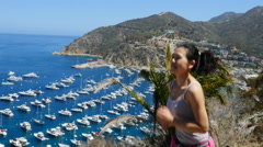 Woman Jogging on Catalina Island in California Stock Footage
