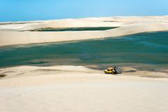 Jericoacoara, Ceara state, Brazil - July 2016: Buggy with tourists traveling  Stock Photos