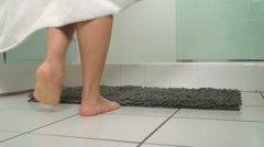 Woman Entering Shower - stock footage