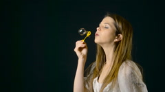 Pretty Woman Blowing Bubbles Slow Motion - stock footage