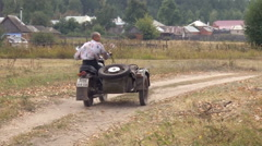 Russian Countryside. Man Riding Motocycle Sidecar Stock Footage