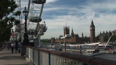 London eye and river with Big Ben and buildings in background Stock Footage