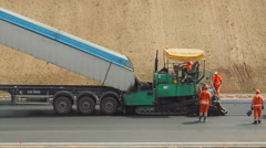 Works on asphalting the highway Stock Footage
