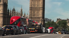 London westminster bridge red bus taxi and parliament in shot Stock Footage