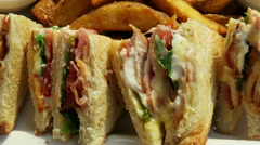 Club sandwich with chicken, country fries on a plate with mustard and ketchup Stock Footage