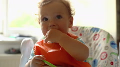 Lovely baby is looking to camera ta the kitchen Stock Footage