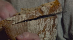 Cutting and Giving Bread. Closeup Stock Footage